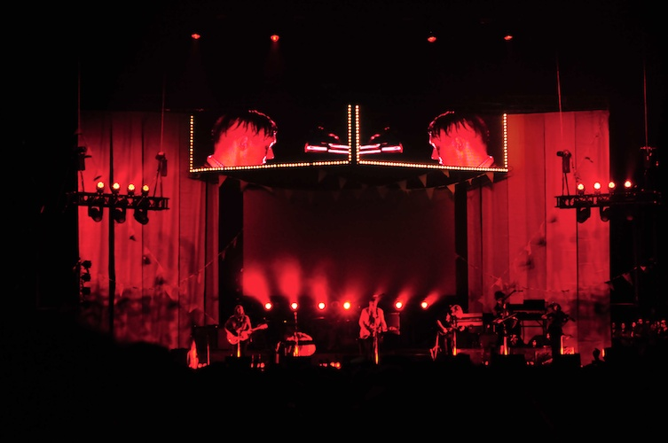 Arcade Fire in red.